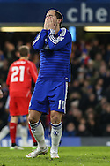 Eden Hazard of Chelsea holds his face in his hands after missing chance to open the scoring during the Capital One Cup Semi Final 2nd Leg match between Chelsea and Liverpool at Stamford Bridge, London, England on 27 January 2015. Photo by David Horn.