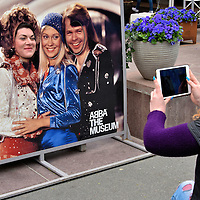 Band Member Face Cutouts at ABBA Museum in Stockholm, Sweden<br /> In front of the ABBA Museum is a photo of the Swedish pop group members (left to right) Benny Andersson, Anni-Frid Lyngstad, Agnetha F&auml;ltskog and Bj&ouml;rn Ulvaeus.  Their faces have cutouts that allow tourists to replace their own for a photo op. The band was only active for ten years starting in 1972 yet their music is still widely heard, especially in the stage production of Mama Mia!  The museum of memorabilia opened in Stockholm in May of 2013.