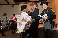 Goshen, New York - Orange County Sheriff Carl DuBois shakes hands with a new American citizen during a Naturalization ceremony at the county Emergency Services Center on Nov. 17, 2016.