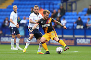 Bradford City striker Billy Clarke (10) tries to play around Bolton Wanderers midfielder Jay Spearing (8) during the EFL Sky Bet League 1 match between Bolton Wanderers and Bradford City at the Macron Stadium, Bolton, England on 24 September 2016. Photo by Simon Brady.
