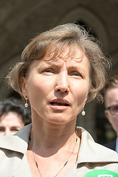 Image ©Licensed to i-Images Picture Agency. 31/07/2014. London, United Kingdom. Public Inquiry in to the death of Alexander Litvinenko is opened. Image shows his widow Marina Litvinenko outside the High Court. Picture by i-Images
