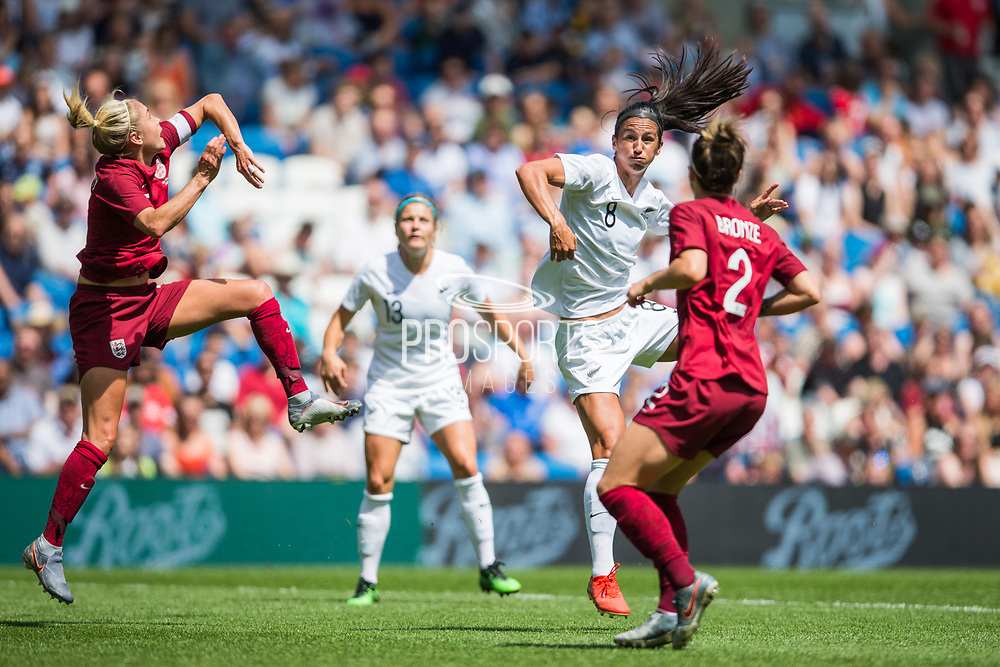 Alex Greenwood (England) & Ria Percival (New Zealand) after heading the ball during the FIFA Women's World Cup UEFA warm up match between England Women and New Zealand Women at the American Express Community Stadium, Brighton and Hove, England on 1 June 2019.