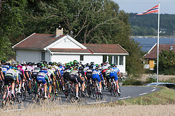 The peloton approaches the short gravel section of Stage 2 of the Ladies Tour of Norway - a 140.4 km road race, between Sarpsborg and Fredrikstad on August 19, 2017, in Ostfold, Norway. (Photo by Balint Hamvas/Velofocus.com)
