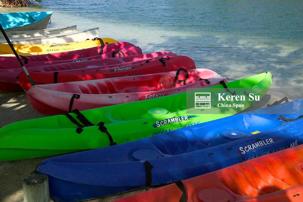 Colorful kayaks on the beach, Roatan, Bay Islands, Honduras