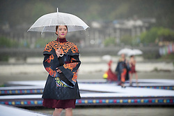 A model presents a creation of She ethnic group during an outdoor fashion contest held at Jingning She Autonomous County in Lishui, east China's Zhejiang Province, April 9, 2016. EXPA Pictures © 2016, PhotoCredit: EXPA/ Photoshot/ Li Suren<br /> <br /> *****ATTENTION - for AUT, SLO, CRO, SRB, BIH, MAZ, SUI only*****