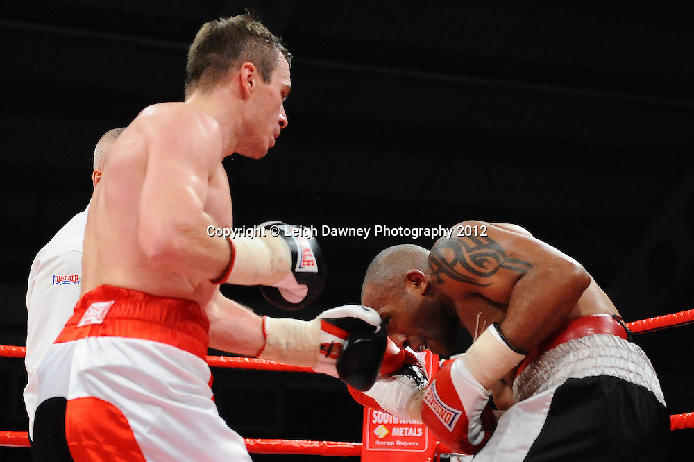 Neil L Perkins (red/black shorts) defeats Dee Mitchell in 4x3 Light Middleweight contest on the 30th November 2012 at Aintree Equestrian Centre, Aintree, Liverpool. Frank Maloney Promotions. Pictures by Leigh Dawney. ©leighdawneyphotography 2012.