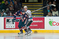 KELOWNA, CANADA - MARCH 11: Tyson Baillie #24 of Kelowna Rockets checks Ondrej Vala #42 of Kamloops Blazers during second period on March 11, 2016 at Prospera Place in Kelowna, British Columbia, Canada.  (Photo by Marissa Baecker/Shoot the Breeze)  *** Local Caption *** Tyson Baillie; Ondrej Vala;