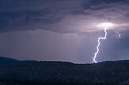 Rain storm over Otowi Mesa with lightning, located in the Pajarito Plateau on the east side of the Jemez Mountains, © 2014 David A. Ponton