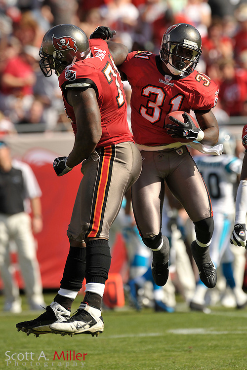 Tampa Bay Buccaneers cornerback Phillip Buchanon (31) and defensive end Jovan Haye (71) celebrate a play during the Bucs game against the Carolina Panthers at Raymond James Stadium on Dec. 30, 2007 in Tampa, Florida.                          ..©2007 Scott A. Miller
