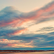 I was initially disappointed when I went to the beach in Cape Ann, MA. for sunrise shots.  The sky was cloudy, so there wan't much to shoot of the rising sun.  When I looked to my left, I saw the clouds beautifully illuminated by the rising sun.