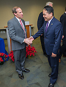 Houston ISD trustee Greg Meyers, left, and Director General Louis M. Huang, right, of the Taipei Economic and Cultural Office in Houston, shake hands after signing a partnership agreement during a ceremony, December 17, 2015.