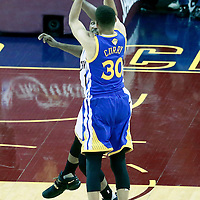 08 June 2016: Golden State Warriors guard Stephen Curry (30) takes a jump shot over Cleveland Cavaliers center Tristan Thompson (13) during the Cleveland Cavaliers 120-90 victory over the Golden State Warriors, during Game Three of the 2016 NBA Finals at the Quicken Loans Arena, Cleveland, Ohio, USA.