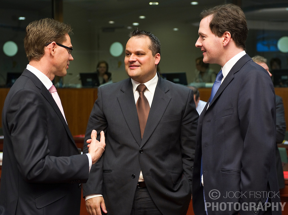 Jan Kees De Jager, the Netherlands's finance minister, center, speaks with Jyrki Katainen, Finland's finance minister, left, and George Osborne, the UK's chancellor of the exchequer, during the meeting of European Union finance ministers in Brussels, Belgium, on Tuesday, May 18, 2010. (Photo © Jock Fistick)