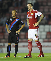 Crystal Palace's Kevin Phillips (Left) and Bristol City's Aden Flint (right)  - Photo mandatory by-line: Joe Meredith/JMP - Tel: Mobile: 07966 386802 27/08/2013 - SPORT - FOOTBALL - Ashton Gate - Bristol - Bristol City V Crystal Palace -  Capital One Cup - Round 2