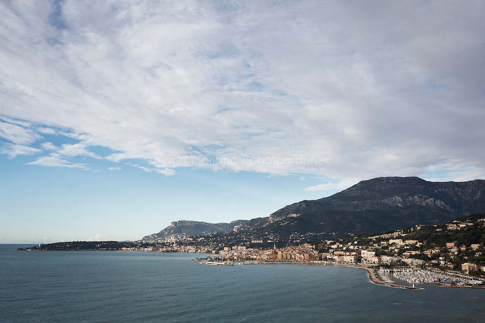 VENTIMIGLIA, ITALY - 17 NOVEMBER 2014: The city of Menton seen from Ventimiglia, Italy, on November 17th 2014.<br /> <br /> The Ventimiglia-Menton border is the border between Italy and France crossed by migrants who decide to continue their journey up north towards countries such as Germany, Sweden, The Netherlands and the UK where the process to receive the refugee status or humanitarian protection is smoother and faster. in Ventimiglia, Italy, on November 17th 2014.