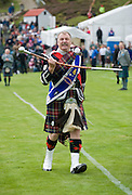 BRAEMAR, UNITED KINGDOM - SEPTEMBER 06: Annual Braemar Highland Gathering on September 6, 2008 in Braemar, Scotland. The Braemar Gathering is the most famous of the Highland Games and is known Worldwide. Each year thousands of visitors descend on this small Scottish village on the first Saturday in September to watch one of the more colourful Scottish traditions. The Gathering has a long history and in its modern form it stretches back nearly 200 years.