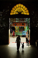 Mother and son arriving at Botataung pagoda, Yangon