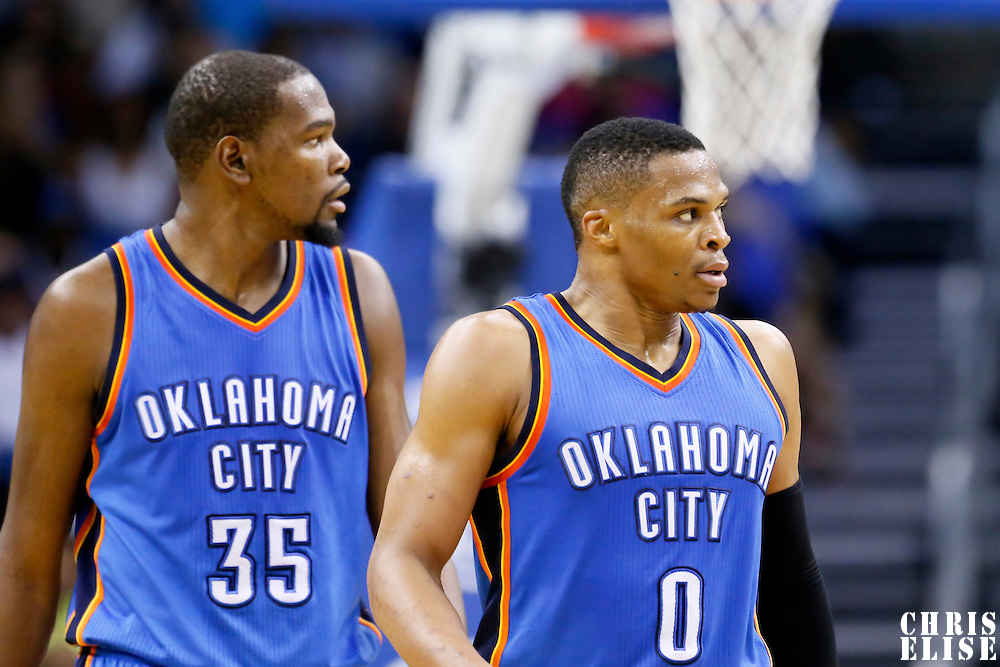 30 October 2015: Oklahoma City Thunder guard Russell Westbrook (0) is seen next to Oklahoma City Thunder forward Kevin Durant (35) during the Oklahoma City Thunder 139-136 double overtime victory over the Orlando Magic, at the Amway Center, in Orlando, Florida, USA.