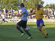 FODBOLD: Dennis Borup (Helsingør) presser Remco van der Schaaf (Brøndby) under opvisningskampen mellem Elite 3000 Helsingør og Brøndby IF den 16. juni 2010 på Helsingør Stadion. Foto: Claus Birch