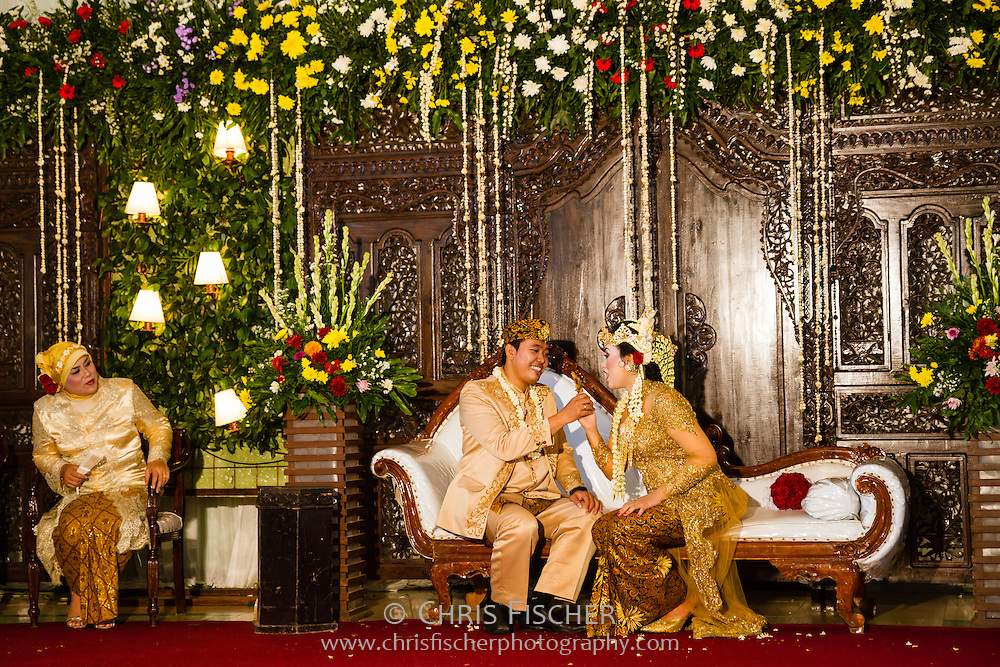 The happy couple during their traditional Sundanese wedding ceremony in Cianjur, West Java, Indonesia.