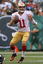 Sept 30, 2012; East Rutherford, NJ, USA; San Francisco 49ers quarterback Alex Smith (11) looks to pass during the first half at MetLIfe Stadium.