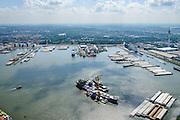 Nederland, Zuid-Holland, Rotterdam, 10-06-2015;  Marcor stuwadoors in Waalhaven. Overslag van agri bulk met drijvende grijperkranen van bulkopslag vaartuig naar binnenvaartschepen. Rechts Waalhaven-Zuid.<br /> Marcor stevedoring in Waal harbour. Transhipment of agri bulk with floating grab cranes from bulk storage vessel to barges.<br /> <br /> luchtfoto (toeslag op standard tarieven);<br /> aerial photo (additional fee required);<br /> copyright foto/photo Siebe Swart