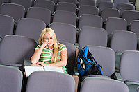 Student sleeping in lecture hall