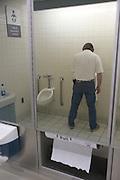 man in a public toilet
