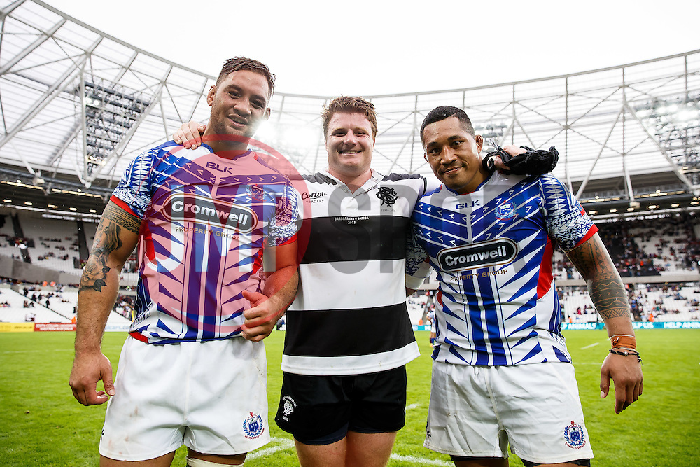 Bristol Rugby players Jack Lam of Samoa, Kyle Traynor of the Barbarians and Anthony Perenise of Samoa pose together at the end of the match - Mandatory byline: Rogan Thomson/JMP - 07966 386802 - 29/08/2015 - RUGBY UNION - The Stadium at Queen Elizabeth Olympic Park - London, England - Barbarians v Samoa - International Friendly.
