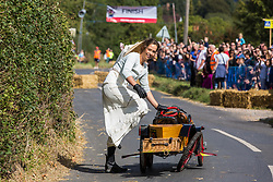 Cookham Dean, UK. 1 September, 2019. A custom-built kart named Chitty Chitty Bang Bang competes in the Cookham Dean Gravity Grand Prix in aid of the Thames Valley and Chiltern Air Ambulance.