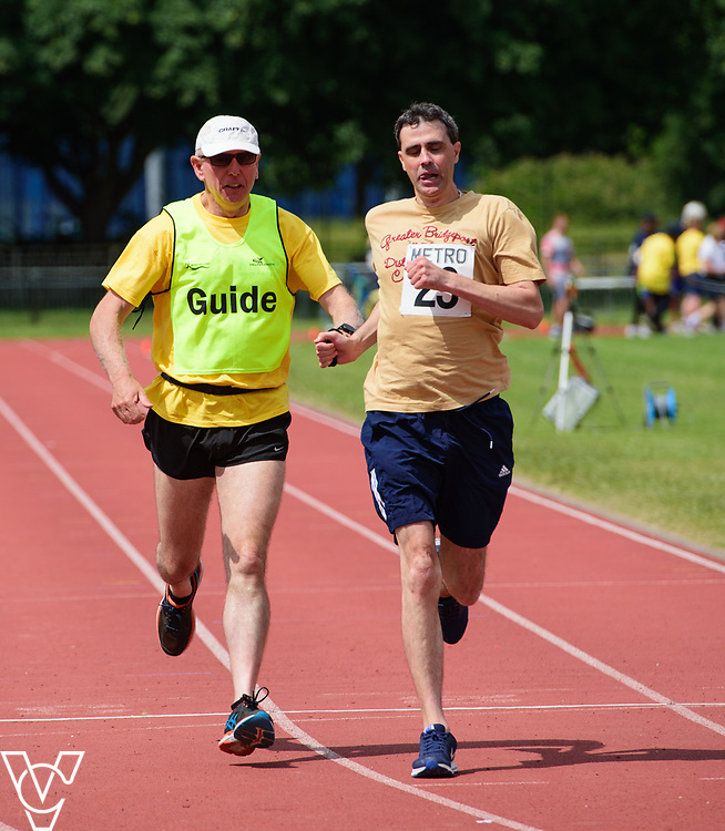 Metro Blind Sport's 2017 Athletics Open held at Mile End Stadium.  200m Senior Men - Final.  Tim Morrice with guide runner<br /> <br /> Picture: Chris Vaughan Photography for Metro Blind Sport<br /> Date: June 17, 2017