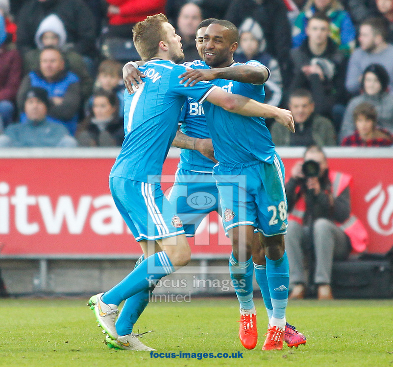 Jermain Defoe (R) celebrates the first goal for Sunderland during the Barclays Premier League match at the Liberty Stadium, Swansea<br /> Picture by Mike Griffiths/Focus Images Ltd +44 7766 223933<br /> 07/02/2015