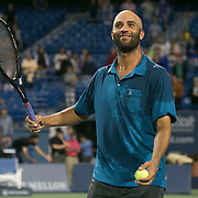 August 21, 2014, New Haven, CT:<br /> James Blake hits balls to fans during the Men's Legends Event on day seven of the 2014 Connecticut Open at the Yale University Tennis Center in New Haven, Connecticut Thursday, August 21, 2014.<br /> (Photo by Billie Weiss/Connecticut Open)