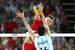 07.09.2014, Centennial Hall, Breslau, POL, FIVB WM, Polen vs Argentinien, Gruppe A, im Bild (L) MARTIN RAMOS. (P) PIOTR NOWAKOWSKI // during the FIVB Volleyball Men's World Championships Pool A Match beween Poland and Argentina at the Centennial Hall in Breslau, Poland on 2014/09/07. <br /> <br /> ***NETHERLANDS ONLY***