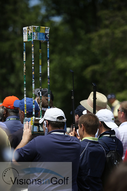 fans looking through periscopes<br /> on the second day at the US Open Championship, Merion East, PA. USA 2013 <br /> Picture Credit:  Mark Newcombe / visionsingolf.com