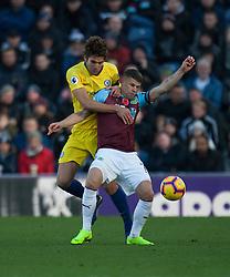 Marcos Alonso of Chelsea (L) and Johann Gudmundsson of Burnley in action - Mandatory by-line: Jack Phillips/JMP - 28/10/2018 - FOOTBALL - Turf Moor - Burnley, England - Burnley v Chelsea - English Premier League