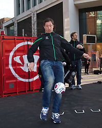 LIVERPOOL, ENGLAND - Thursday, April 10, 2014: Liverpool's Robbie Fowler hands out signed balls to the crowd at the launch of the new Warrior home kit for 2014/2015 at the Liverpool One shopping centre. (Pic by David Rawcliffe/Propaganda)