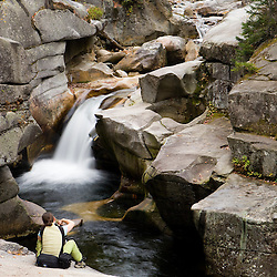 A photographer at Upper Falls on the Ammonoosuc River in New Hampshire's White Mountains. Twin Mountain, New Hampshire.