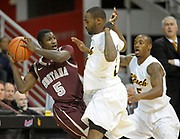 Feb 19, 2011; Long Beach, CA, USA; Montana Grizzlies guard Will Cherry (5) is defended by Long Beach State 49ers guards Larry Anderson (21) and Brandon Nevens (5) at the Walter Pyramid. Long Beach State defeated Montana 74-56.