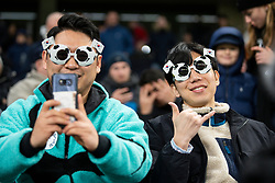 LONDON, ENGLAND - Saturday, January 11, 2020: Two Tottenham Hotspur supporters wearing novelty football sunglasses with South Korean flags during the FA Premier League match between Tottenham Hotspur FC and Liverpool FC at the Tottenham Hotspur Stadium. (Pic by David Rawcliffe/Propaganda)