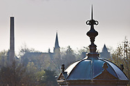 Four pinnacles pointing skyward in Batavia, Illinois. The foreground pinnacle is the roof of the Gunzenhauser gazebo located at the Depot Museum.