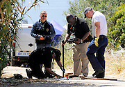 Scotland Yard forensic technician sending a camera down a sewage hole a place where there have seen abnormal evidence in the ground in  Praia da Luz  as they look for the body of Maddie McCann.<br /> ©Exclusivepix