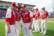 Holy Redeemer&rsquo;s Cade Flanley, center, hugs teammates Robb McClay, left, and Mark Mangan after the Royals fell 8-3 to Central High School in the PIAA Class 3A baseball championship at Medlar Field at Penn State on Thursday, June 15, 2017.<br />