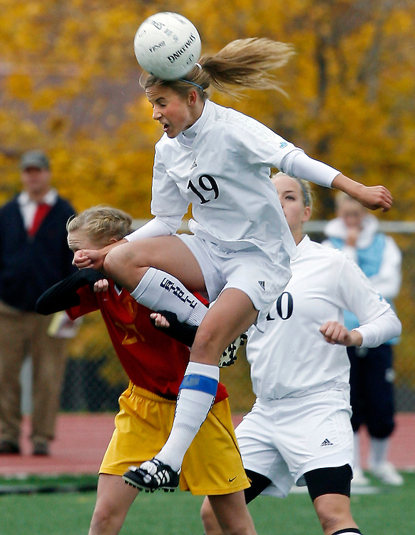 Juan Diego's Olivia Wee heads the ball over Judge Memorial's Tess Burick, but Judge Memorial defeats Juan Diego Catholic 1-0 to take the 3A State Girls Soccer Championship at Woods Cross High School in Woods Cross, Utah Saturday, Oct. 20, 2007.  August Miller/ Deseret Morning News .