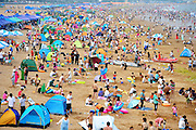 QINGDAO, CHINA - JULY 16: <br /> <br /> Tourists play on the beach on July 16, 2016 in Qingdao, Shandong Province of China. Qingdao beaches attract thousands of tourists everyday in summer. <br /> ©Exclusivepix Media