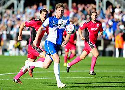 Bristol Rovers' Adam Cunnington goes past Dover Athletic's Tom Bonner - Photo mandatory by-line: Neil Brookman - Mobile: 07966 386802 - 04/10/2014 - SPORT - Football - Bristol - Memorial Stadium - Bristol Rovers v Dover - Vanarama Football Conference