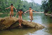 Machiguenga Indian Children playing in River<br />Timpia Community, Lower Urubamba River<br />Amazon Rain Forest, PERU.  South America