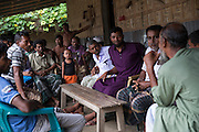 At Borezerdanga village in one of the enclaves near the town of Debiganj a meeting is being held between village elders and men known as 'peace keepers' including Zoynul Hoque, 34, (purple shirt). Here to discuss the issue of an underage marriage, until a few weeks ago when the enclaves were disbanded the Bangladeshi police had no jurisdiction inside the enclaves so residents relied on peace keepers to sort out problems ranging from illegal logging to land disputes.<br /> <br /> Mr Hoque, despite his young age has been a peace keeper for 10 years owing to him attaining a higher education qualification compared to most who live in the chitmahals.<br /> <br /> On July 31st 2015 the enclaves that formed one of the world's most complicated borders were officially absorbed in to the countries that surrounded them in a land-mark land swap between India and Bangladesh. The people that lived in them will finally receive citizenship.<br /> <br /> Enclaves are small pockets of sovereign land completely surrounded by another sovereign nation. Approximately 160 enclaves, known as chitmahals, exist on either side of the India-Bangladesh border. For 68 years the 50,000 plus inhabitants of these enclaves have lived a difficult existence, stranded from their home nation and ignored by the country that surrounds them. <br /> <br /> In theory even leaving their enclaves is illegally crossing an international border and for decades it has been very difficult for them to receive even the most basic of rights whether education or health. Even the police have no jurisdiction in the enclaves leaving them essentially lawless.