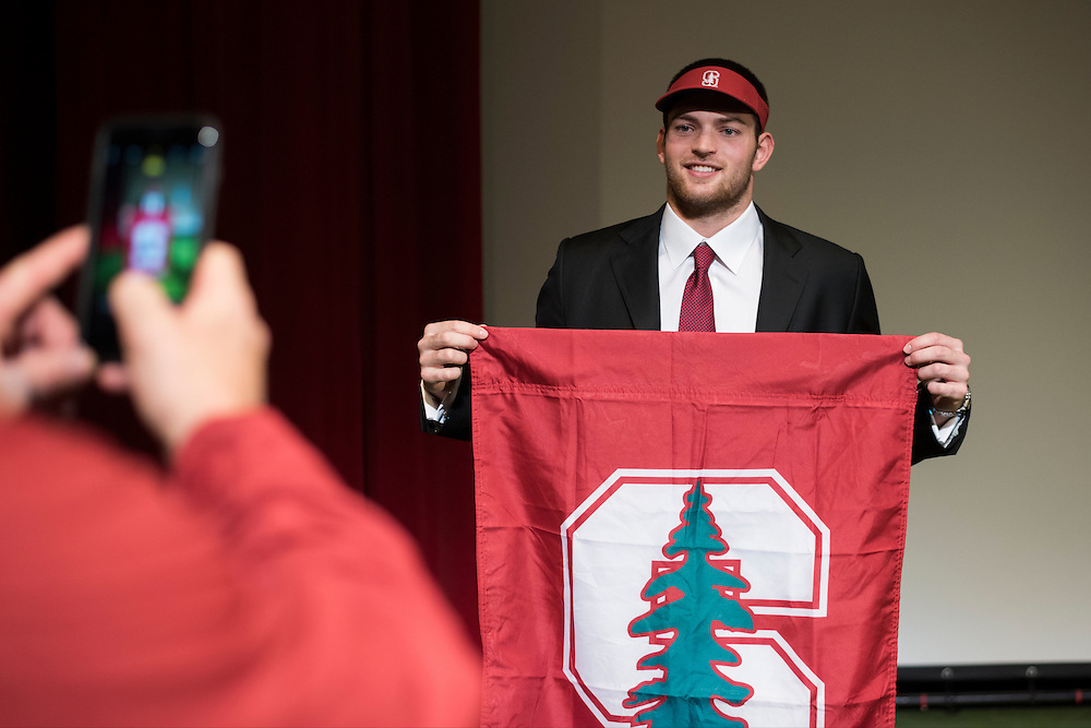Flower Mound Marcus High School senior tight end Kaden Smith poses for a photo for his father, Marc, after signing his National Letter of Intent to play football at Stanford University during his high school signing day on February 3, 2016. (Cooper Neill for The New York Times)