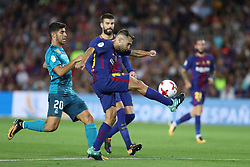 August 13, 2017 - Barcelona, Spain - Jordi Alba of FC Barcelona kicks the ball under pressure from Isco of Real Madrid during the Spanish Super Cup football match between FC Barcelona and Real Madrid on August 13, 2017 at Camp Nou stadium in Barcelona, Spain. (Credit Image: © Manuel Blondeau via ZUMA Wire)